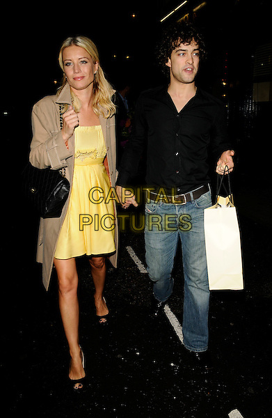 "DENISE VAN OUTEN & LEE MEAD.The ""Hairspray: The School Musical"" gala show, Lyric Theatre, London, England..August 31st, 2008.full length black shirt jeans denim beige mac trench coat couple bag holding hands yellow dress .CAP/CAN.©Can Nguyen/Capital Pictures."