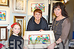 Ali O'Donoghue, and Elaine Clifford Killarney looking at artist Irene Ryan Boherbue (right) ink designs  at the Killarney Rotary Club annual Wine and Art night at the Malton Hotel on Thursday