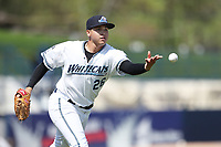 West Michigan Michigan Whitecaps pitcher Eudis Idrogo (26) tosses the ball to first base against the Fort Wayne TinCaps during the Midwest League baseball game on April 26, 2017 at Fifth Third Ballpark in Comstock Park, Michigan. West Michigan defeated Fort Wayne 8-2. (Andrew Woolley/Four Seam Images)