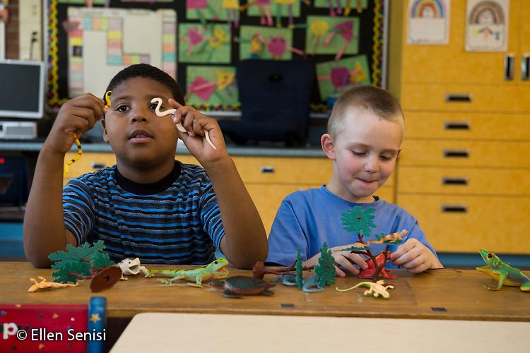 MR / Schenectady, NY. Zoller Elementary School (urban public school). Kindergarten classroom. Students pretend using play reptiles at free playtime. Left: boy, 5, bi-racial; Right: boy, 5. MR: Was3, Hol13. ID: AM-gKw. © Ellen B. Senisi.