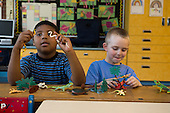 MR / Schenectady, NY. Zoller Elementary School (urban public school). Kindergarten classroom. Students pretend using play reptiles at free playtime. Left: boy, 5, bi-racial; Right: boy, 5. MR: Was3, Hol13. ID: AM-gKw. © Ellen B. Senisi.