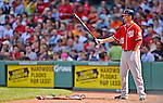 9 June 2012: Washington Nationals first baseman Adam LaRoche stands on deck during play against the against the Boston Red Sox at Fenway Park in Boston, MA. The Nationals defeated the Red Sox 4-2 in the second game of their 3-game series. Mandatory Credit: Ed Wolfstein Photo