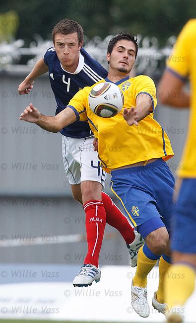 Danny Wilson with Sweden scorer Denni Avdic