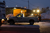 A Night at the Snow Farm<br /> A city worker in his truck at Boston's largest snow farm, South Boston, MA.