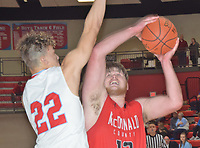 RICK PECK/SPECIAL TO MCDONALD COUNTY PRESS<br /> McDonald County's Cooper Reece scores two of his game-high 25 points while being guarded by Webb City's Jaystin Smith during the Mustangs' 41-35 loss on Feb. 27 in the semifinals of the Missouri Class 4 District 12 Basketball Tournament at Webb City High School.