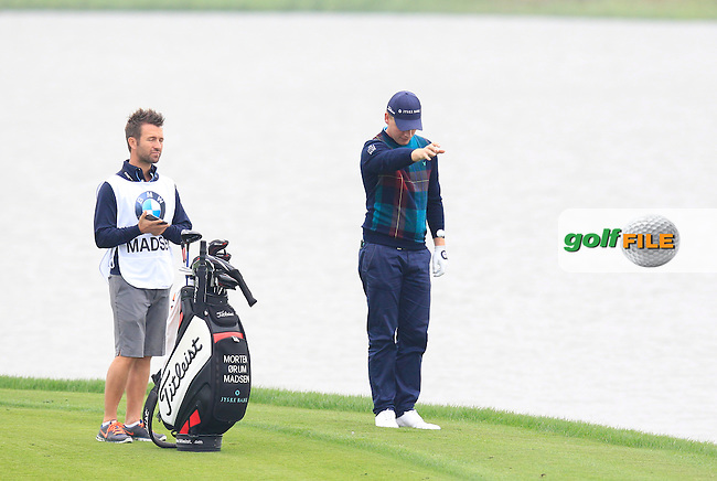 Morten Orum Madsen (DEN) takes a penalty drop on the 13th hole during Sunday's Final Round of the 2014 BMW Masters held at Lake Malaren, Shanghai, China. 2nd November 2014.<br /> Picture: Eoin Clarke www.golffile.ie