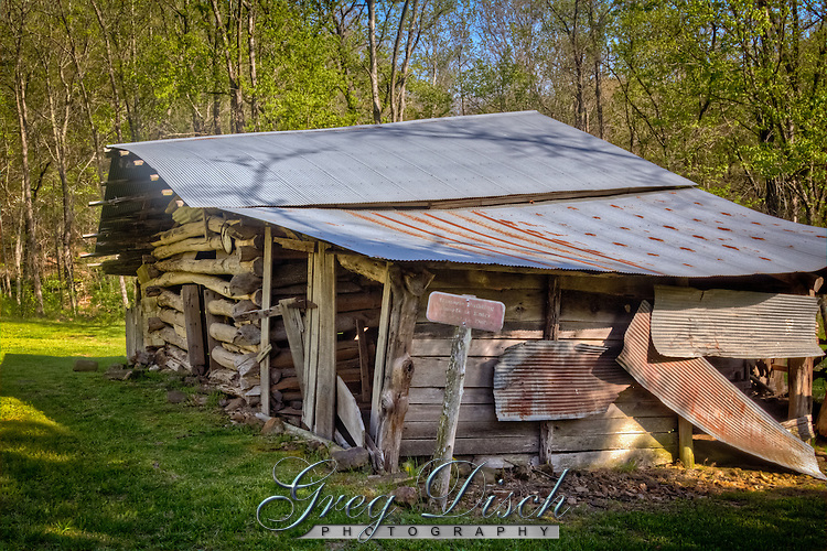 """James Villines was known as """"Beaver Jim"""" for his renowned trapping ability. """"Beaver Jim's"""" homestead. The log house originally built in 1850 with additional outbuildings and a barn."""
