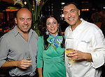 From left: Paolo and Saula Valente with Tammaso Tarantino at the grand opening of the Valentino restaurant at the Hotel Derek Thursday Oct. 15,2009. (Dave Rossman/For the Chronicle)