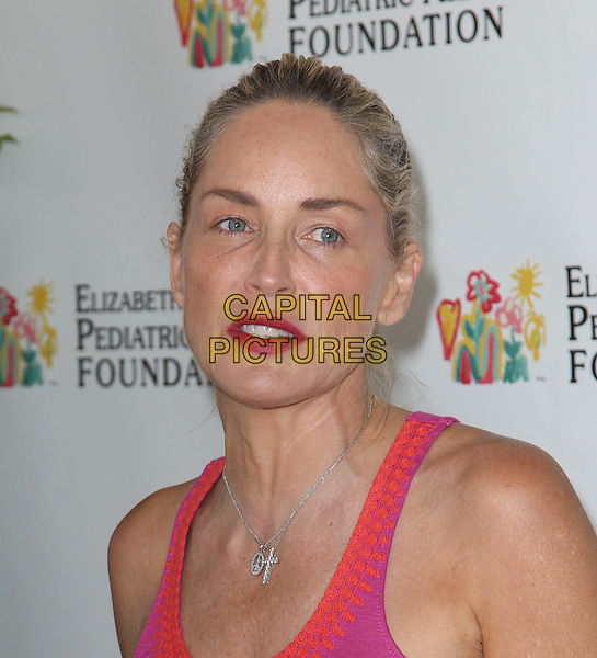 Sharon Stone.Elizabeth Glaser Pediatric AIDS Foundation's 23rd Annual 'A Time For Heroes' Celebrity Picnic held at The Wadsworth Theater, Los Angeles, California, USA..3rd June 2012.headshot portrait pink red .CAP/ADM/FS.©Faye Sadou/AdMedia/Capital Pictures.