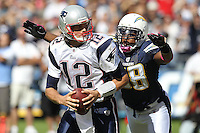 10/24/10 San Diego, CA:  New England Patriots quarterback Tom Brady #12 and San Diego Chargers linebacker Antwan Barnes #98 during an NFL game played at Qualcomm Stadium between the San Diego Chargers and the New England Patriots. The Patriots defeated the Chargers 23-20.