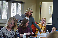 """Life coach Marcie Bayles (third from left) hands out worksheets to students, Monday, February 10, 2020 at the Compton Gardens & Conference Center in Bentonville. Check out nwaonline.com/200211Daily/ for today's photo gallery.<br /> (NWA Democrat-Gazette/Charlie Kaijo)<br /> <br /> Life coach Marcie Bayles held her monthly workshop called """"Why is Joy Elusive? Or is it?"""".  Students of the workshop learn how to enjoy life, solve their own problems and reach their goals through self-coaching personal circumstances and feelings. The workshops are every second Monday of the month at 12:30 pm at the Compton Gardens & Conference Center.<br /> <br /> Bayles's workshop seeks to relieve suffering, prevent mental and emotional crisis and strengthen the mental health of the community."""