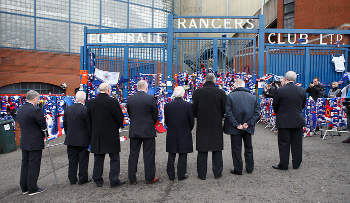Ally McCoist along with Rangers players and staff pay their respects to Sandy Jardine at the Copland Road blue gates at Ibrox