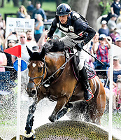 LEXINGTON, KENTUCKY - APRIL 29: Qalao Des Mers #24, with rider Maxime Livio (FRA), have trouble clearing an obstacle but survive during the Cross Country Test at the Rolex Kentucky 3-Day Event at the Kentucky Horse Park on April 29, 2017 in Lexington, Kentucky. (Photo by Scott Serio/Eclipse Sportswire/Getty Images)