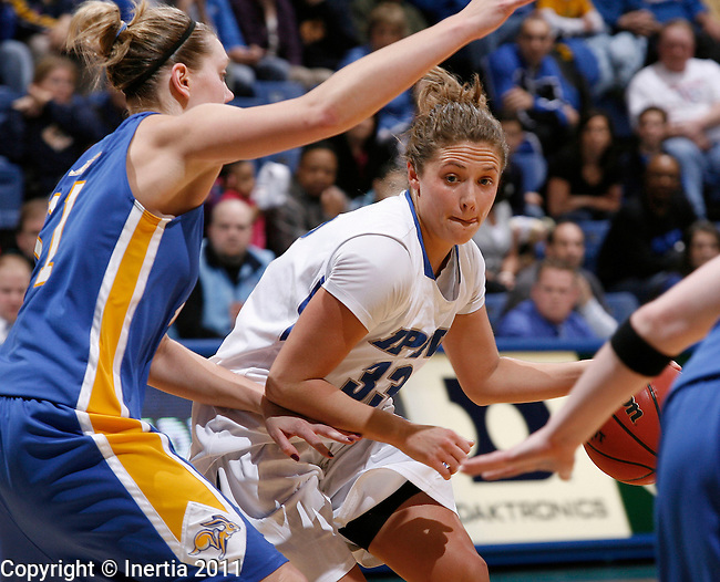 SIOUX FALLS, SD - MARCH 7: Jordan Zuppe #33 of IPFW drives toward Jennie Sunnarborg #31 of South Dakota State during their semi-final game at the 2011 Summit League Basketball Championships in Sioux Falls, S.D. (photo by Dick Carlson/Inertia)