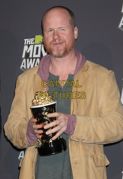 Joss Whedon.2013 MTV Movie Awards held at Sony Pictures Studios, Culver City, California, USA..April 14th, 2013.press room pressroom half length green top tan jacket beard facial hair pink hood award trophy winner  .CAP/ADM/RE.© Russ Elliot/AdMedia/Capital Pictures