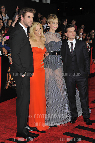 LtoR: Liam Hemsworth, Elizabeth Banks, Jennifer Lawrence &amp; Josh Hutcherson at the US premiere of their movie &quot;The Hunger Games: Catching Fire&quot; at the Nokia Theatre LA Live.<br /> November 18, 2013  Los Angeles, CA<br /> Picture: Paul Smith / Featureflash