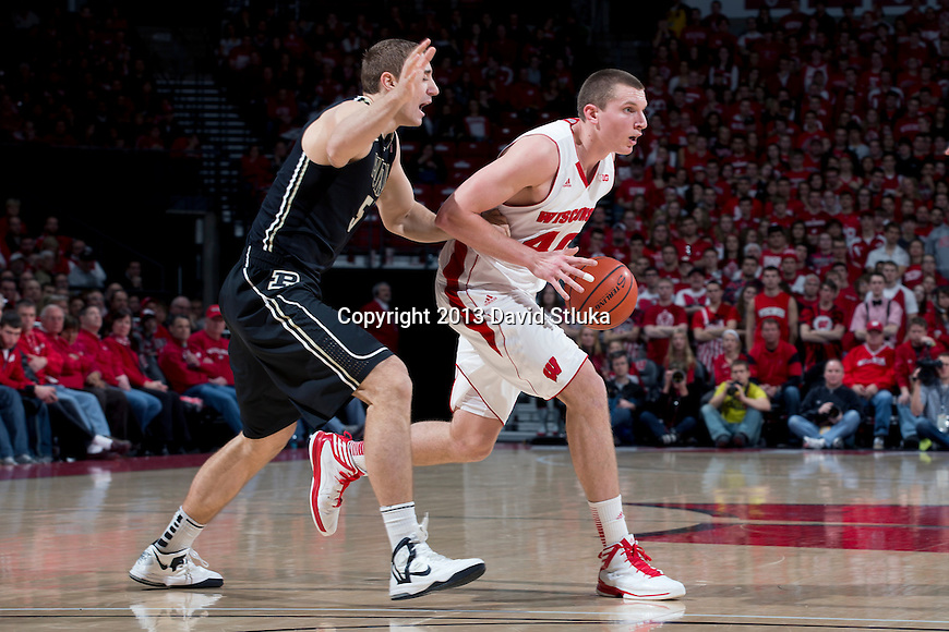 Wisconsin Badgers forward Jared Berggren (40) handles the ball during a Big Ten Conference NCAA college basketball game against the Purdue Boilermakers Sunday, March 3, 2013, in Madison, Wis. Purdue won 69-56. (Photo by David Stluka)