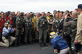 "United States President George W. Bush greets sailors on the flight deck after a successful trap aboard the USS Abraham Lincoln (CVN 72) in a S-3B Viking assigned to the Blue Wolves of Sea Control Squadron Three Five (VS-35) designated ""NAVY 1"" on May 1, 2003. President Bush is the first sitting President to trap aboard an aircraft carrier at sea. The President is conducting a visit aboard ship to meet with the Sailors and will address the Nation as Lincoln prepares to return from a 10-month deployment to the Arabian Gulf in support of Operation Iraqi Freedom. <br /> Credit: United States Navy via CNP"