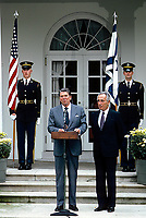 Washington DC., USA, October 9, 1984<br /> President Ronald Reagan meets with Israeli Prime Minister Shimon Peres in the Rose Garden. Credit: Mark Reinstein/MediaPunch