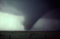 A violent tornado sweeps across mesquite prairie in northwest Texas during the spring.