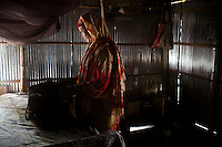 A widow, Rubi Begum, 40, prepares to go to work in her one room home in Ghagoa Villlage, Gobindagonj Upazila, Gaibandha, Bangladesh on 19th September 2011. Living alone after her husband's passing, she has now (since 2.5 years) found financial independence by working as a saleswoman, earning 3500 - 5000 Bangladeshi Taka per month. She is one of many rural Bangladeshi women trained by NGO CARE Bangladesh as part of their project on empowering women in this traditionally patriarchal society. Named 'Aparajitas', which means 'women who never accept defeat', these women are trained to sell products in their villages and others around them from door-to-door, bringing global products from brands such as BATA, Unilever and GDFL to the most remote of villages, and bringing social and financial empowerment to themselves.  Photo by Suzanne Lee for The Guardian