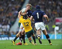 Jonny Gray of Scotland is tackled by Matt Giteau of Australia during the Quarter Final of the Rugby World Cup 2015 between Australia and Scotland - 18/10/2015 - Twickenham Stadium, London<br /> Mandatory Credit: Rob Munro/Stewart Communications