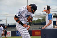 Tampa Tarpons third baseman Angel Aguilar (7) signs autographs for fans before a game against the Clearwater Threshers on April 22, 2018 at George M. Steinbrenner Field in Tampa, Florida.  Tampa defeated Clearwater 2-1.  (Mike Janes/Four Seam Images)