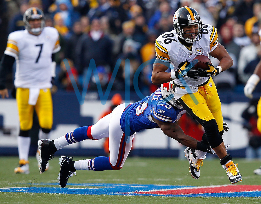 ORCHARD PARK, NY - NOVEMBER 28:  Hines Ward #86 of the Pittsburgh Steelers runs through a tackle by Drayton Florence #29 of the Buffalo Bills after completing a catch during the game on November 28, 2010 at Ralph Wilson Stadium in Orchard Park, New York.  (Photo by Jared Wickerham/Getty Images)