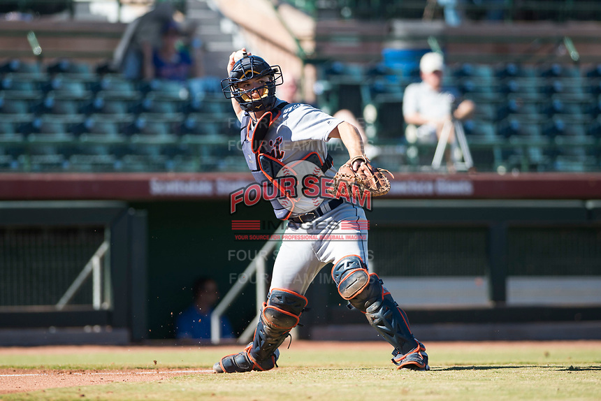 Mesa Solar Sox catcher Jake Rogers (8), of the Detroit Tigers organization, throws to first base during an Arizona Fall League game against the Scottsdale Scorpions at Scottsdale Stadium on November 2, 2018 in Scottsdale, Arizona. The shortened seven-inning game ended in a 1-1 tie. (Zachary Lucy/Four Seam Images)