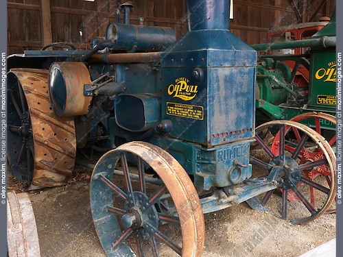 Antique Oil Pull Rumely tractor in a museum of agricultural equipment in Canada