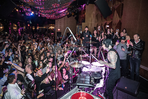 LAS VEGAS, NV - December 31, 2016: ***HOUSE COVERAGE*** Travis Barker performs at New Years Eve set at Vanity Nightclub at Hard Rock Hotel & Casino in Las vegas, NV on December 31, 2016. Credit: GDP Photos/ MediaPunch
