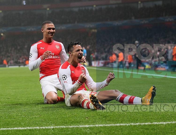 Arsenal's Alexis Sanchez celebrates scoring his sides second goal<br /> <br /> UEFA Champions League- Arsenal vs Borussia Dortmund- Emirates Stadium - England - 26th November 2014 - Picture David Klein/Sportimage