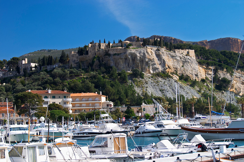 In the harbour in Cassis village.  Fishing and leisure boats moored at the key side. Cassis Cote d'Azur Var France Bouches du Rhone