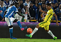 BOGOTA - COLOMBIA - 07 – 04 - 2017: Deiver Machado (Izq.) jugador de Millonarios disputa el balón con Aldo Leao Ramirez (Der.) jugador de Atletico Nacional, durante partido de la fecha 12 entre Millonarios y Atletico Nacional, por la Liga Aguila I-2017, jugado en el estadio Nemesio Camacho El Campin de la ciudad de Bogota. / Deiver Machado (L) player of Millonarios vies for the ball with Aldo Leao Ramirez (R) player of Atletico Nacional, during a match of the date 12 between Millonarios and Atletico Nacional, for the Liga Aguila I-2017 played at the Nemesio Camacho El Campin Stadium in Bogota city, Photo: VizzorImage / Luis Ramirez / Staff.