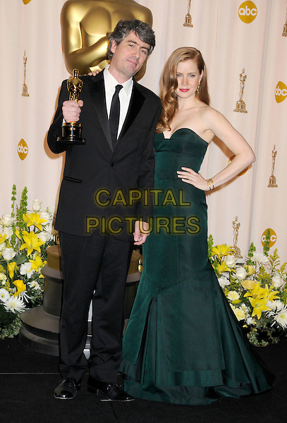 DARIO MARIANELLI & AMY ADAMS.The 80th Annual Academy Awards Press Room held at the Kodak Theatre, Hollywood, California, USA..February 24th, 2008.oscars award trophy winner full length black suit green strapless dress hand on hip.CAP/ADM/BP.©Byron Purvis/AdMedia/Capital Pictures.