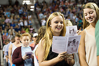 2016 Fall Convocation in Humphrey Coliseum: students sing the MSU Alma Mater.<br />  (photo by Megan Bean / &copy; Mississippi State University)