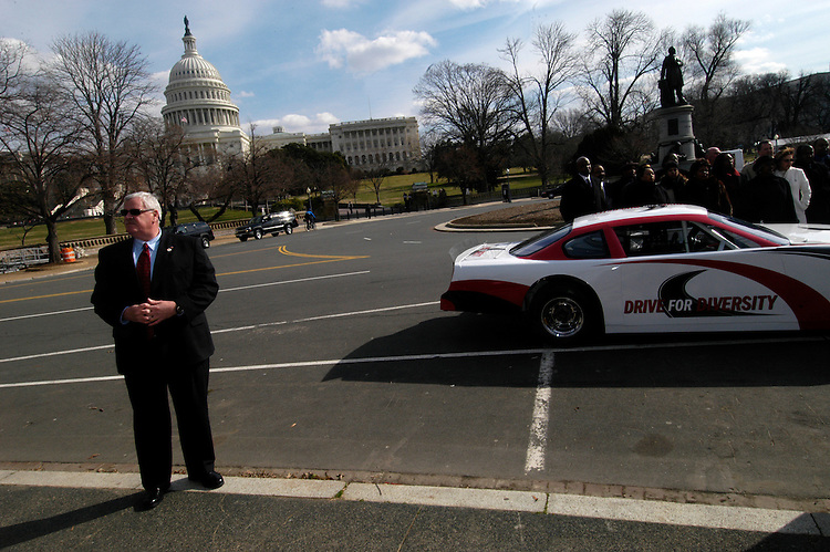 Speaker of the House Dennis Hastert's security detail at a press conference to announce a a consortium between historically black colleges and NASCAR, to increase diversity in the sport and create job opportunities.