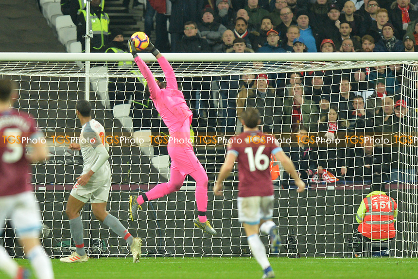Alisson Becker of Liverpool jumps and catches a cross during West Ham United vs Liverpool, Premier League Football at The London Stadium on 4th February 2019
