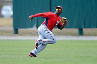 Washington Nationals outfielder Brian Goodwin #23 tracks down a fly ball during a minor league Spring Training game against the Detroit Tigers at Tiger Town on March 22, 2013 in Lakeland, Florida.  (Mike Janes/Four Seam Images)
