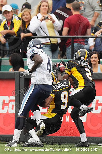September 6, 2010; Hamilton, ON, CAN; Hamilton Tiger-Cats defensive back Jason Shivers (2) intercepts a pass in the end zone intended for Toronto Argonauts wide receiver James Robinson (4). CFL football: Labour Day Classic - Toronto Argonauts vs. Hamilton Tiger-Cats at Ivor Wynne Stadium. The Tiger-Cats defeated the Argonauts 28-13. Mandatory Credit: Ron Scheffler.