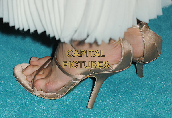 Abigail Spencer's shoes.Special Screening of 'Chasing Mavericks' held at The Pacific Grove Stadium 14 in Los Angeles, California, USA..October 18th, 2012.detail feet heels open toe white  gold beige silk satin.CAP/RKE/DVS.©DVS/RockinExposures/Capital Pictures.