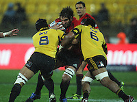 Sam Whitelock runs into a tackle. Super 15 rugby match - Crusaders v Hurricanes at Westpac Stadium, Wellington, New Zealand on Saturday, 18 June 2011. Photo: Dave Lintott / lintottphoto.co.nz