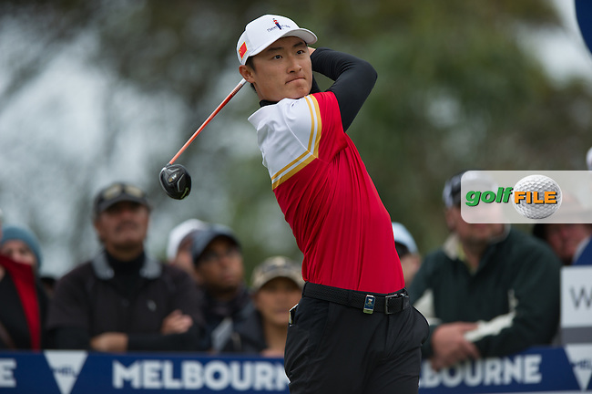 Li Haotong (CHN) during the final round at the ISPS Handa World Cup of Golf, from Kingston heath Golf Club, Melbourne Australia. 27/11/2016<br /> Picture: Golffile | Anthony Powter<br /> <br /> <br /> All photo usage must carry mandatory copyright credit (&copy; Golffile | Anthony Powter)