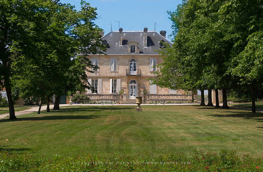 A view of the chateau building across the grass lawn in the garden Chateau Kirwan, Cantenac Margaux Medoc Bordeaux Gironde Aquitaine France