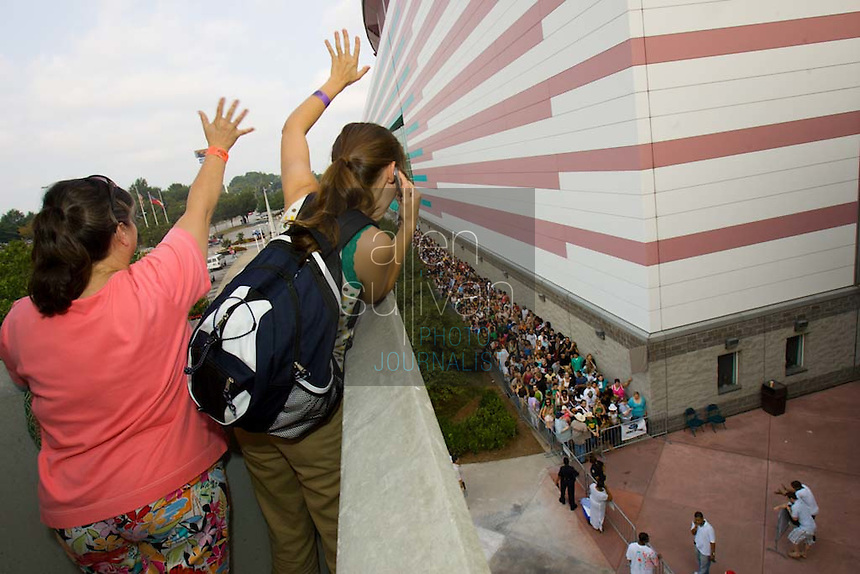 """Sandra Pritchett (left) and her daughter Tabitha wave to one of Tabitha's college friends in line at the Georgia Dome in Atlanta on Sunday during registration to audition for the hit television show """"American Idol."""" Tryouts will be held on Tuesday at the Dome. Tabitha said she wasn't sure what she will audition with, but """"it will probably be a country song."""""""