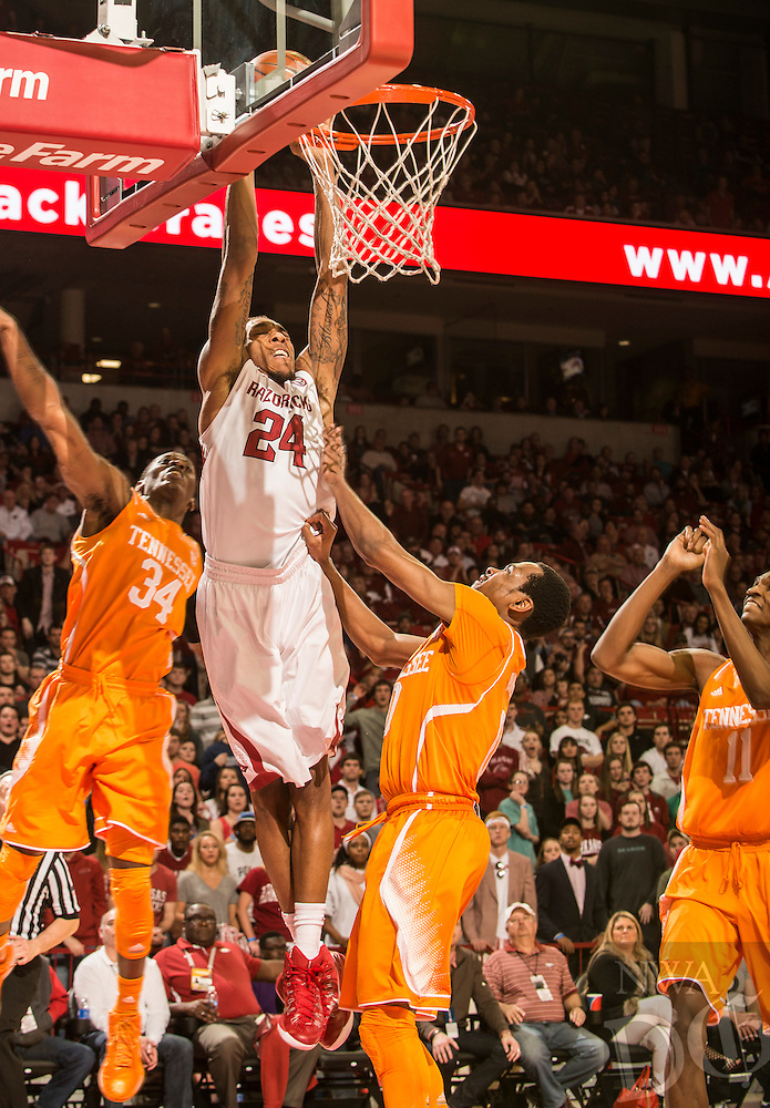 NWA Democrat-Gazette/ANTHONY REYES &bull; @NWATONYR<br /> Michael Qualls, Arkansas junior, dunks against Tennessee in the second half Tuesday, Jan. 17, 2015 in Bud Walton Arena in Fayetteville. The Razorbacks won 69-64.