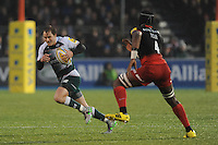 Mathew Tait of Leicester Tigers goes round Maro Itoje of Saracens during the Premiership Rugby match between Saracens and Leicester Tigers - 02/01/2016 - Allianz Park, London<br /> Mandatory Credit: Rob Munro/Stewart Communications