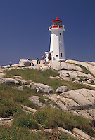 lighthouse, Peggy's Cove, fishing village, Nova Scotia, NS, Canada, Atlantic Ocean, The old lighthouse stands on top of a massive granite rock in Peggy's Cove in Nova Scotia.