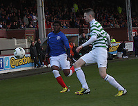 Mark Barrowman comes across to challenge Junior Ogen in the Celtic v Rangers City of Glasgow Cup Final match played at Firhill Stadium, Glasgow on 29.4.13,  organised by the Glasgow Football Association and sponsored by City Refrigeration Holdings Ltd..