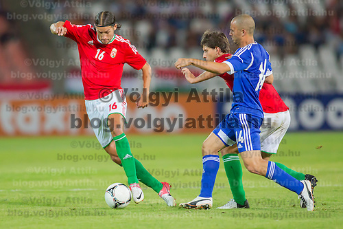 Hungary's Peter Halmosi (L) and Israel's Gil Naftali Vermouth (front R) fight for the ball during a friendly football match Hungary playing against Israel in Budapest, Hungary on August 15, 2012. ATTILA VOLGYI